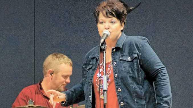 ALBUM LAUNCH: Drummer Tim Bacon with country singer Sharon Heaslip.