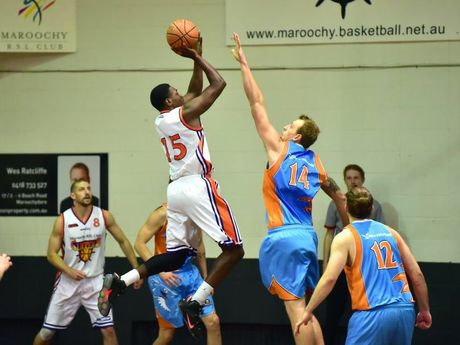Suncoast Clippers' Eren Moses rises above Cairns Marlins' Matthew Andronicos to shoot.