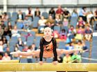IN PHOTOS: Gymnasts tumble for state championships