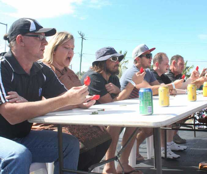 BREATHING FIRE: The contestants get ready for round three in the Yeppoon Chilli Eating competition, held at the Capricorn Coast PCYC.
