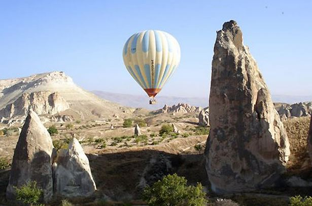 In this photograph taken in September 2006 a hot air balloon flies over the Cappadocia area of central Turkey. A similar balloon crashed in the area Friday May 29 2009 , killing a British tourist and injuring nine other passengers.