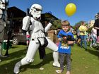 Jessie's Party in the Park rasing money for Give Me 5 For Kids at Caloundra. Max Miletic takes cahrgev of a Storm Trooper from 501st Legion. Photo: Warren Lynam / Sunshine Coast Daily