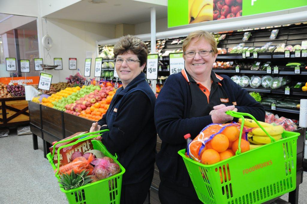 Foodworks staff member Carmel Gaskey with owner Debbie Smith.