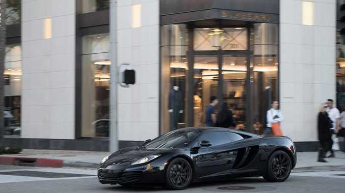 STEALTHY SUPERCAR: McLaren 12C prowls Beverly Hills to the delight of teenage car blogger Jesse See