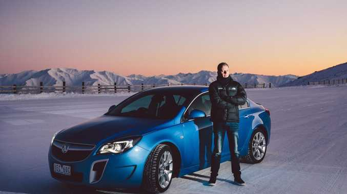SUPER CAR? Race ace James Courtney is VXR ambassador and proved at home on ice as he does the race track
