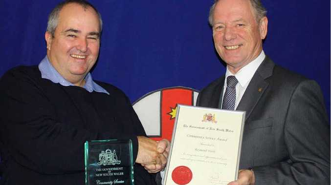 RECOGNITION: Coffs Harbour MP Andrew Fraser awards former fire captain Ray Webb with a Community Service Award.