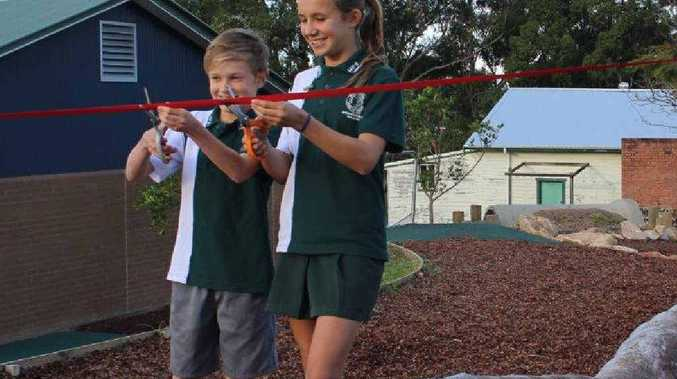 PLAY TIME: School captains Jessica and Lachlan cut the ribbon at the opening of Woolgoolga Public School's new playground.SUPPORTERS: Sam Broomfield of Build by the Sea and Duan March, P&C; president during construction, with the thank you sign erected at the playground.PLAY TIME: Lachlan and Jessica.
