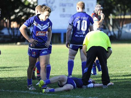 MAN DOWN: Mitchell Gorman down for the count during the Toohey's New Group 2 Rugby League match between the Grafton Ghosts and the Nambucca Roosters at the Frank McGuren Park on Sunday.