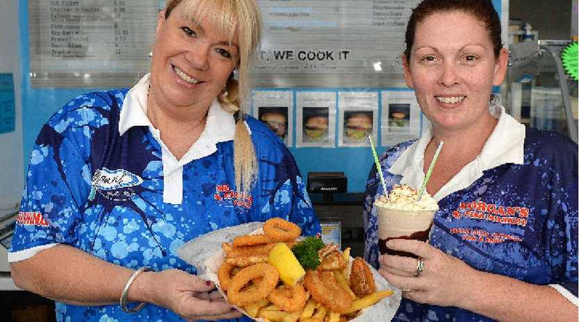 HAPPY STAFF: At Morgan's Fish Market and Take Away in North Mackay are Kelly Morgan and Trish Tait.