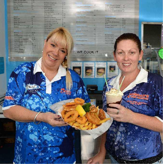 HAPPY STAFF: At Morgan's Fish Market and Take Away in North Mackay are Kelly Morgan and Trish Tait.
