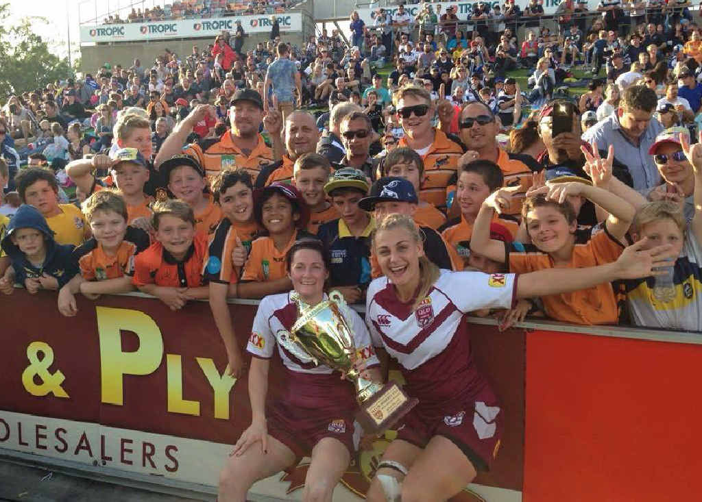 GOOD ENOUGH: Chelsea Baker and Kody House celebrate with the Wallabys under-11s in Townsville after Queensland drew New South Wales 4-all to retain the interstate challenge trophy.