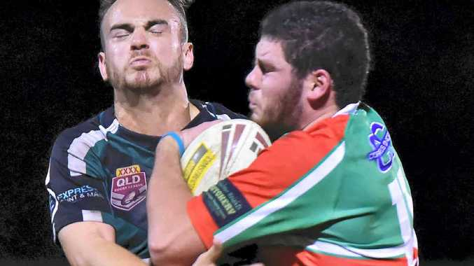 CRUNCH: Nambour's Mitch Oakes is tackled by a Maroochydore player.