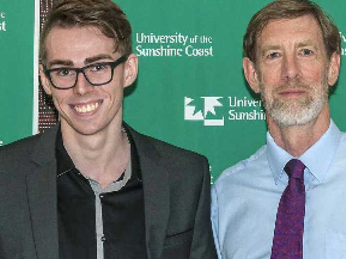 DELIGHTED: Joe Hirst (left), who is one of five winners of the USC Faculty of Arts and Business awards, with Ken Waddington, whose firm Garland Waddington Solicitors donated the prizes.