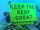 SINKING? Greenpeace activists display a banner during a protest on the Great Barrier Reef.