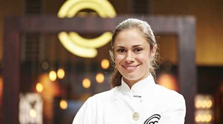 *WARNING EMBARGOED - cannot run in print until Wednesday June 24, cannot go online until 8.30pm Tuesday June 23* MasterChef contestant Ashleigh Bareham wins an immunity pin. Supplied by Channel 10.