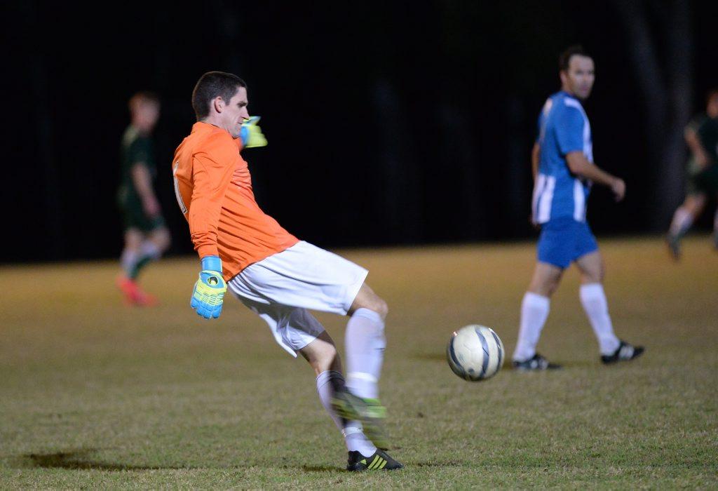 Bluebirds GK Andrew Poyser clears the ball. Photo Allan Reinikka / The Morning Bulletin
