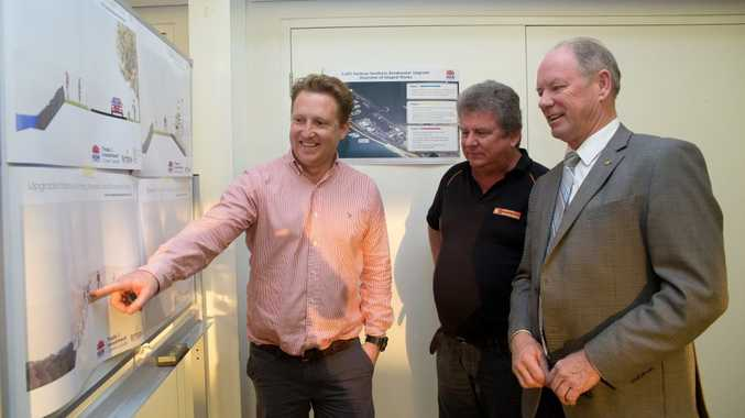 Coastal engineer with Crown Lands, Andy Hartley talks Cr Garry Innes and Member for Coffs Harbour Andrew Fraser through the preferred North Wall design at the Cavanbah Centre.