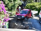 A Buderim resident was lucky to avoid crashing into a neighbours house when his handbrake failed and a reverse hill start was near imposible. He was forced to sit in the vehicle with his foot on the brake until towing services were able to drag the vehicle to safety. Photo: Che Chapman / Sunshine Coast Daily