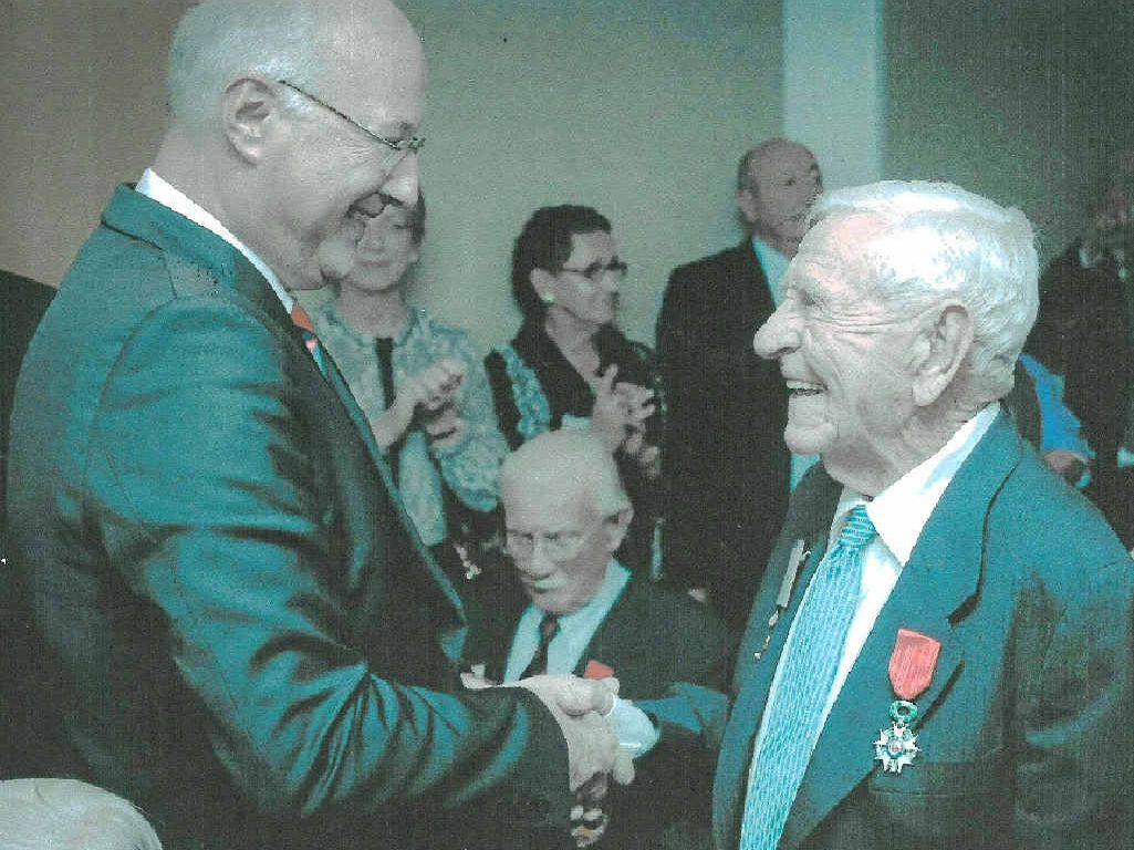 Bellingen resident Hal Hobson receives France's highest decoration, the Legion of Honour, from the Consulate-General of France Eric Berti.