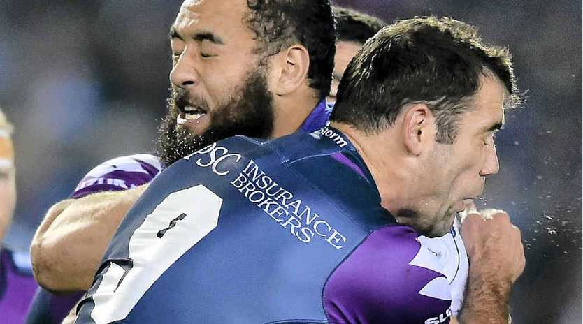 NOT THIS TIME: Sam Kasiano of the Bulldogs is tackled by Cameron Smith.