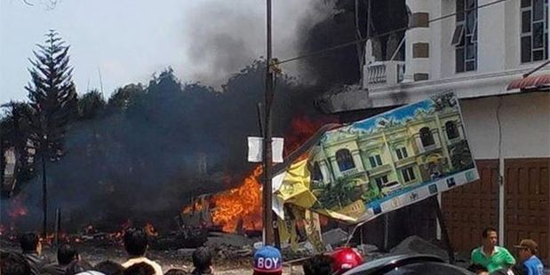 An Indonesian military transport plane has crashed in a city on Sumatra Island. Photo / Via Twitter