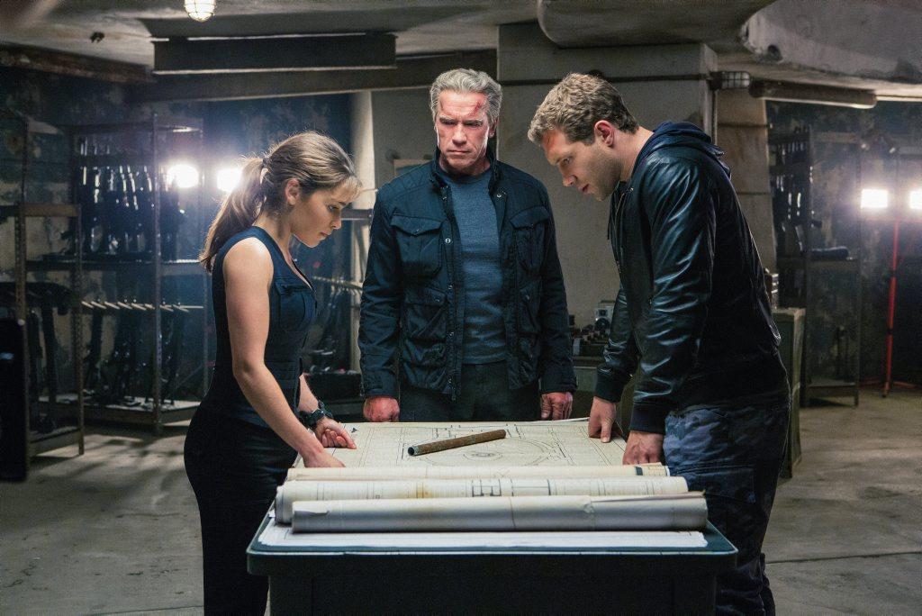 Emilia Clarke, Arnold Schwarzenegger and Jai Courtney in a scene from Terminator Genisys.