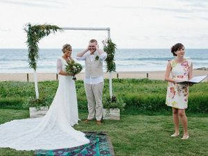 FUN PROTEST: Abbey and Mitchell Johnston cover their ears as wedding celebrant Alison Bartlett reads the monitum.