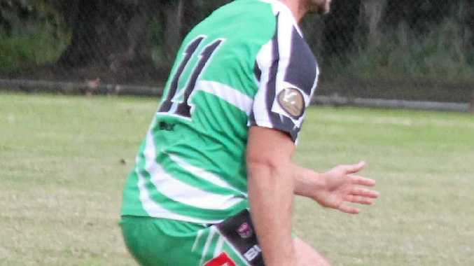 BLOCK: Players player Andrew Gray prepares to defend Caloundra players.