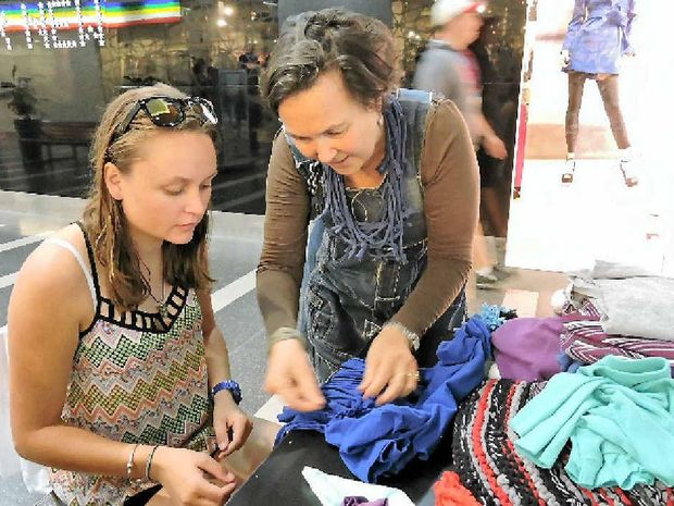 GETTING CRAFTY: Jane Milburn (right) teaching Mikaela Moroney to upcycle a t-shirt at the Caneland Central workshop yesterday.