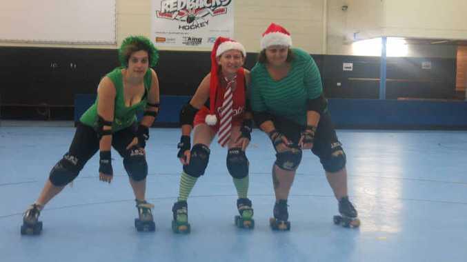 Corinda Robertson, aka Rump of Steelskin, Melissa Maddox, aka Mad Oxe and Kym Jones, aka Bricks, training for the Christmas in July bout on the 18th.