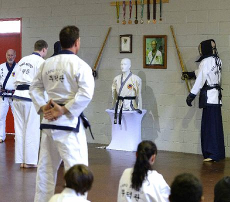 Southern Cross Tang Soo Do master Gordon Rickard and members Louis Johnson and Jarrod Price pay their respects to their friend Masaki Iida who died earlier this year.
