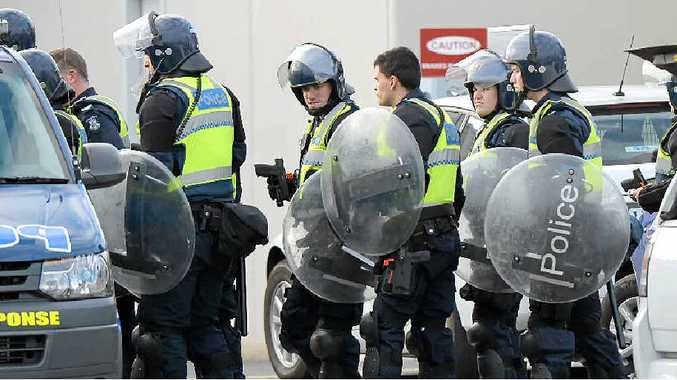 GEARED UP: Riot police at the Metropolitan Remand Centre in Ravenhall.