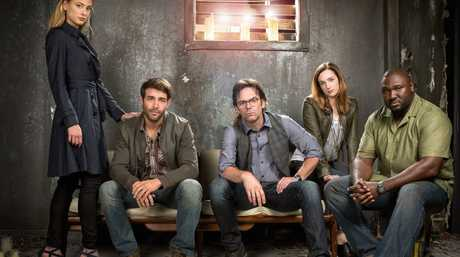 From left, Nora Arnezeder, James Wolk, Billy Burke, Kristen Connolly and Nonso Anozie star in the TV series Zoo.