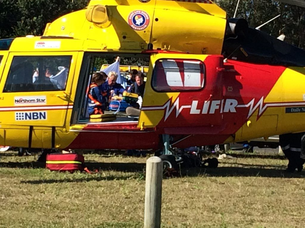 Westpac Life Saver Rescue Helicopter paramedics tend to the victim of a shark attack at Lighthouse Beach, Ballina this morning.