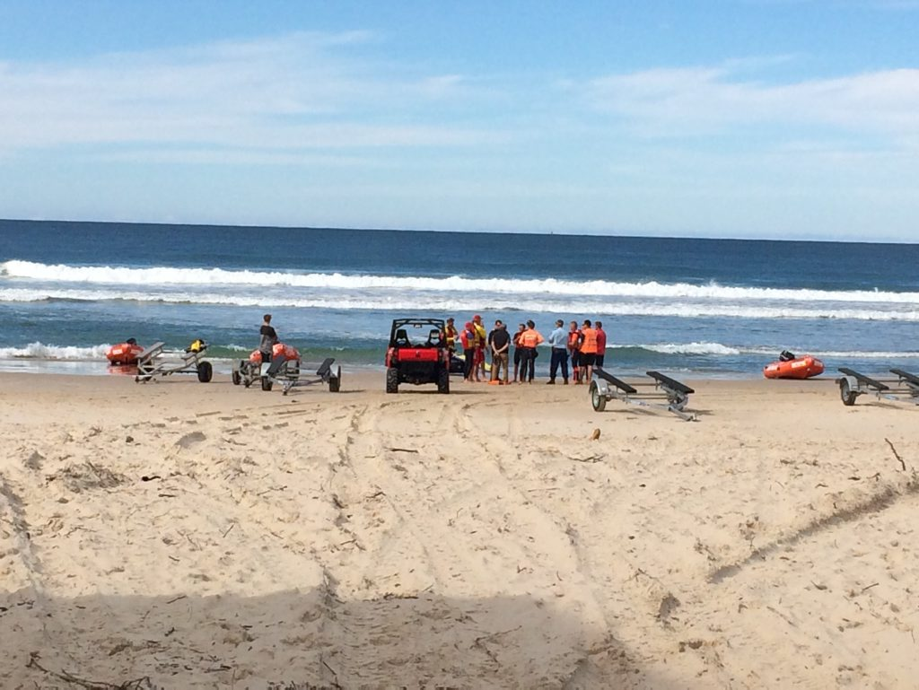 Paramedics tend to the victim of a shark attack at Lighthouse Beach, Ballina this morning.