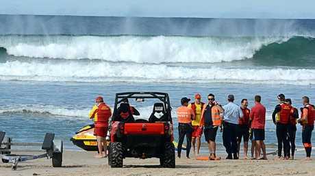 Surf lifesavers patrol Lighthouse Beach, Ballina, near where a 32 year old Ballina man was attacked by a shark.