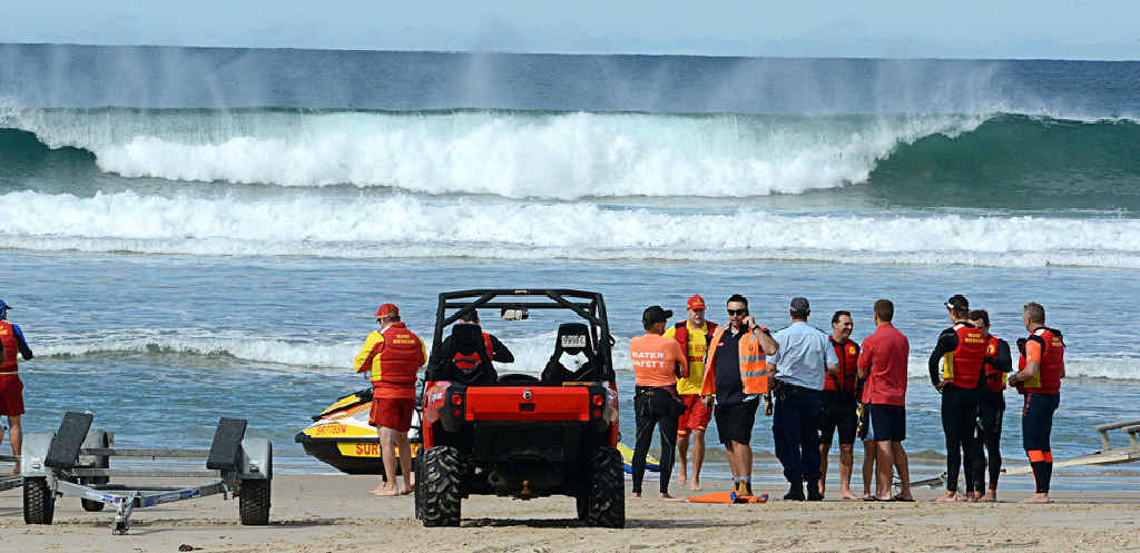 Surf lifesavers patrol Lighthouse Beach, Ballina, near where a 32 year old Ballina man was attacked by a shark.