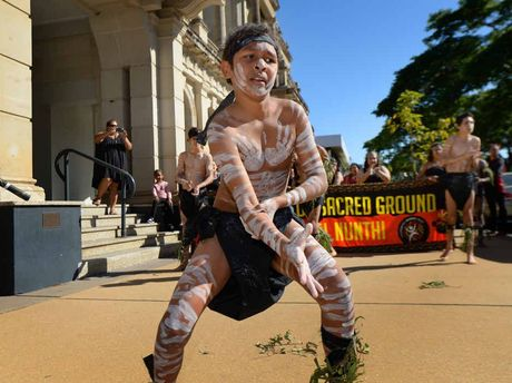 "DANCE CULTURE: Michael ""Booranggai"" Young and fellow Gurridalla Dancers perform during the NAIDOC banner parade down East Street to the Kern Arcade."