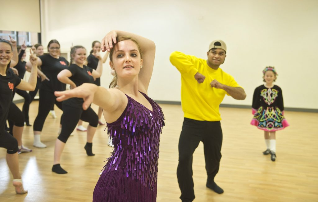 Maddy Cybulski and Olotesi Koka rehearse for the Creative Generation dance performance.
