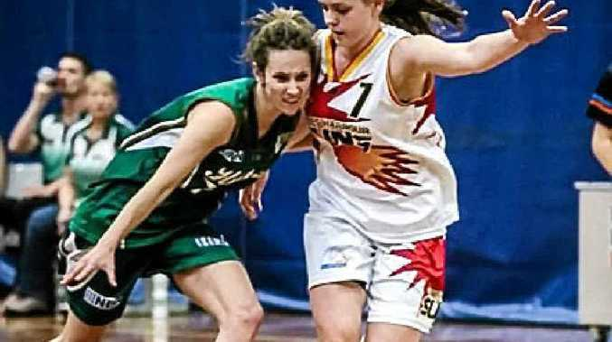 RUGGED: Emily Malouf defends against Newcastle.
