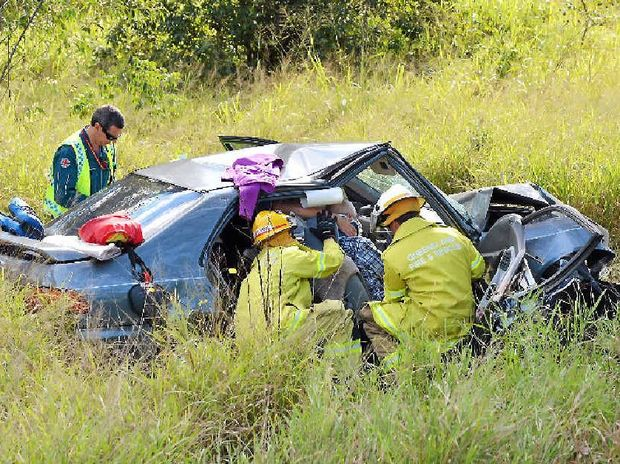 DANGEROUS: An elderly Gympie man is freed from the wreckage of his car on Thursday after the most recent serious accident on the Bruce Hwy just south of Gympie.