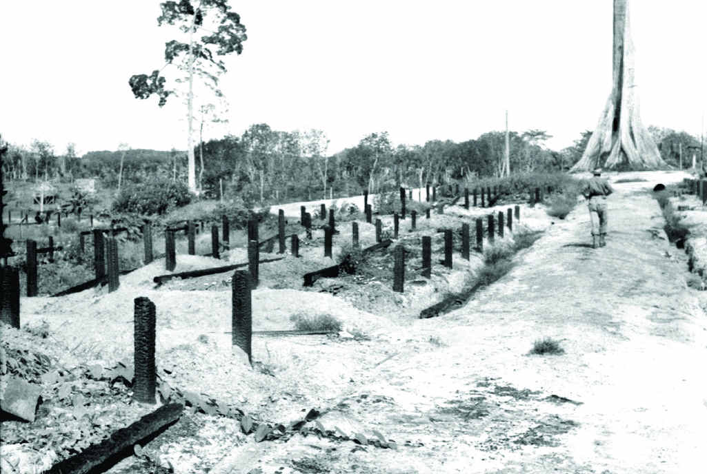 ABOVE RIGHT: Sandakan, October 24, 1945. North East Borneo Force. In an area of no. 1 compound of Sandakan Prisoner of War Camp, the bodies of 300 prisoners were discovered. They were believed to have been those left after two Death Marches to Ranau.