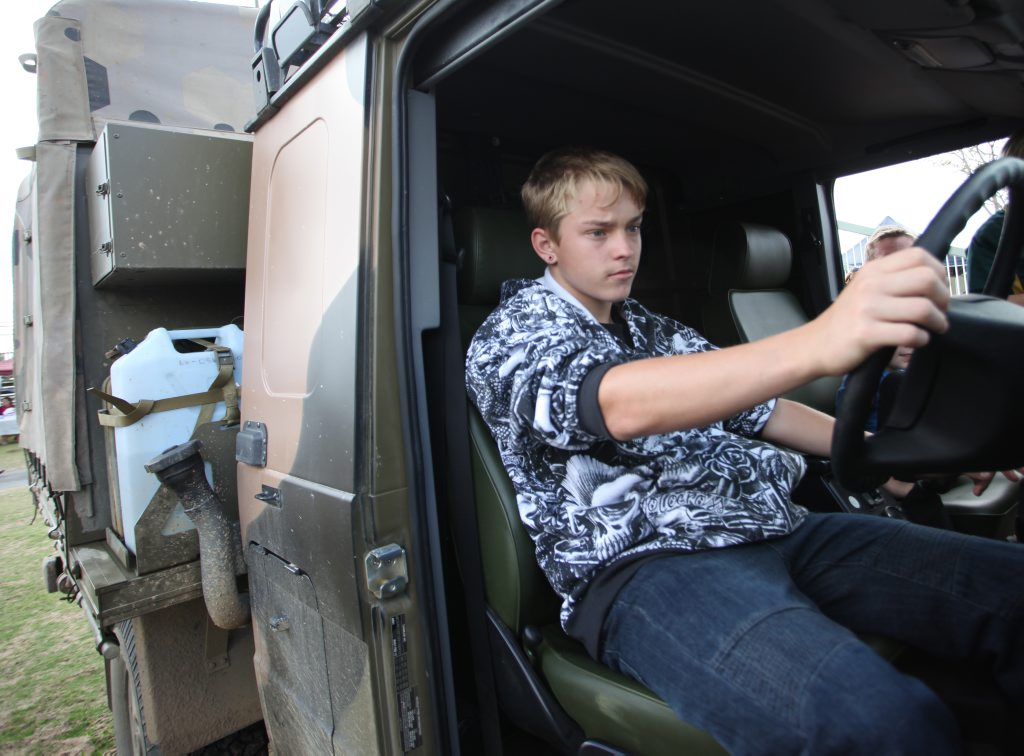 Jesse Osbourne tries out the drivers seat of a vehicle at the Talisman Saber open day. Photo Allan Reinikka / The Morning Bulletin