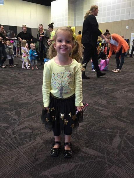Tatam Skinner wrote: 'Laci's first Wiggles concert. She had a ball!'