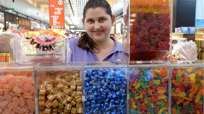 TREATS: Tiffany Edge, of Candy Time at Caneland Central, with red frogs, Sherbies and many other lollies available after manufacturer Allen's announced cuts to some product lines.
