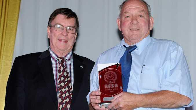 RFSA president Tim Arnott presents the award to Wal Gatley.