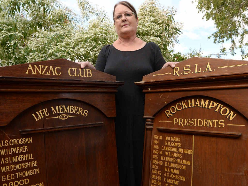 CHANCE FIND: Lyn Clark with the two honour boards returned to Rockhampton after being found in a second-hand store in Brisbane.
