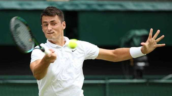 Bernard Tomic of Australia returns to Novak Djokovic of Serbia in their third round match during the Wimbledon Championships at the All England Lawn Tennis Club, in London, Britain, 03 July 2015.