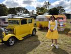 Michelle Heywood, of Brisbane, matches her outfit to her 1929 Tudor and 1966 Sunliner caravan.