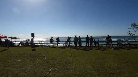 Surf Lifesavers watch over an Oz Grom contestants at Lennox Head after two shark attacks in the space of a week.